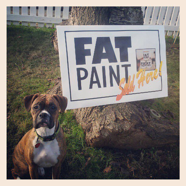 Our shop dog Juno standing by one of our first retailers proudly displaying they sell FAT Paint!